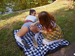 Lusty girls are having a threesome in the nature, in the middle of the day