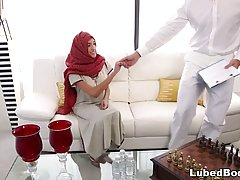 Arab chick is wearing a head scarf during an erotic massage that includes a bit of fucking